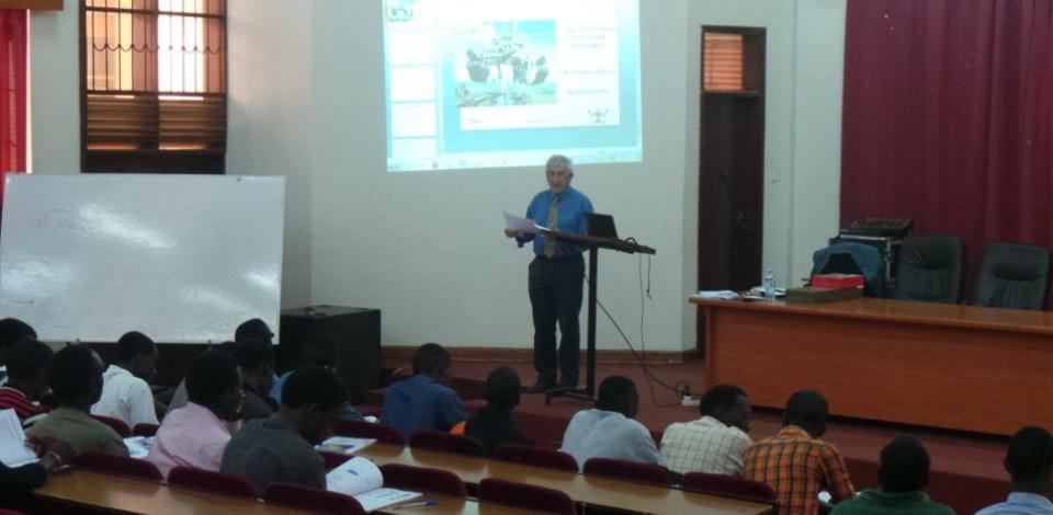 Professor Michel Founteau delivers a lecture at Makerere University in Kampala