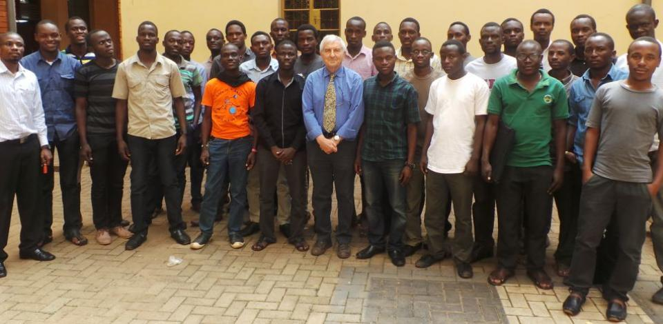Professor Michel Founteau poses with his class at Makerere University in Kampala