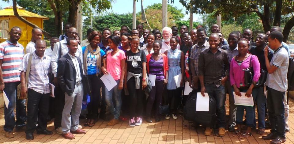 Professor Jean Marie Flament poses with his class at Makerere University in Kampala
