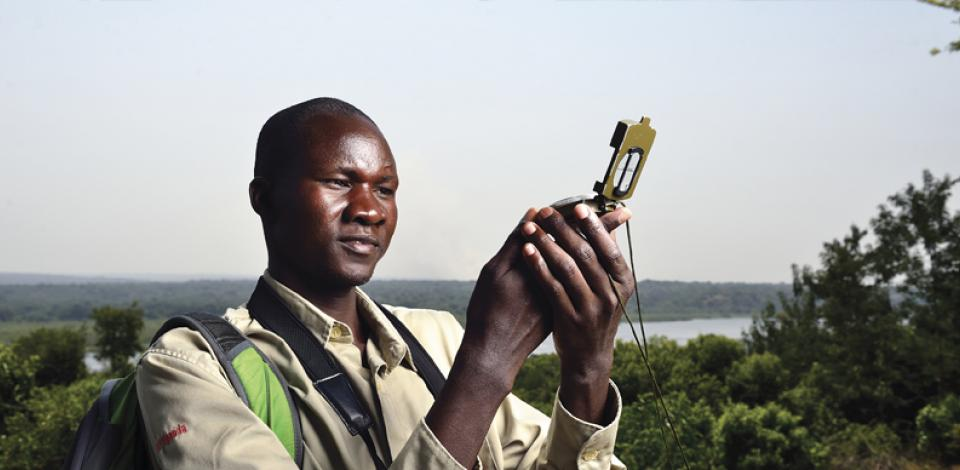 Richard, a biodiversity team member working in the Murchison Falls National Park