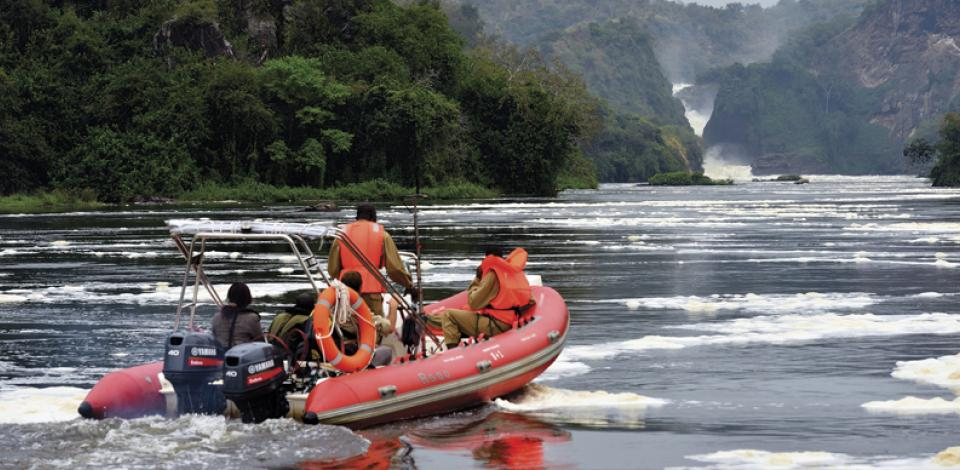 Our team crossing the Nile river at the Murchison Falls