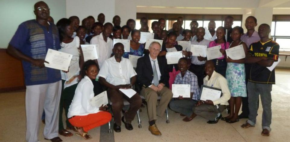 Professor Jean Marabelle poses with his class at Makerere University Business School in Kampala