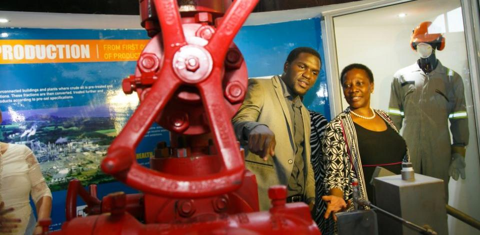 Total E&P Uganda's Planning Engineer Moses discusses the 'Christmas tree' with the Minister